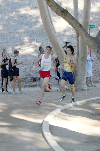 Jayden Emerson is leading the runners in Saturday's 66th Mt. SAC Cross Country Invitational. Jayden finished first out of 100 boys with a time of 15:41. Teammate Tanner Torrez was fourth and the Hemet Boys team finished second overall out of 15 boys teams. Photo by Jessica Priefer