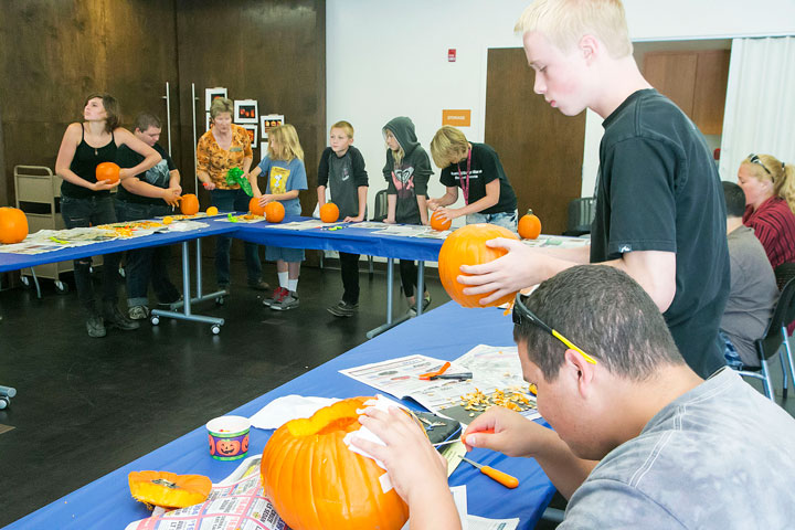 """Pumpkin Carving: Many teens came out to carve pumpkins and watch """"Beetle Juice"""" at the Idyllwild Library Saturday. Kids had two hours to finish their pumpkins, and many took home the seeds to roast for the Halloween holiday. Photo by Jenny Kirchner"""