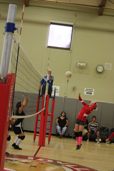 Nicole Cochrane (on right) of Idyllwild School's girls volleyball team returns a serve from the Noli team Wednesday. Idyllwild won the match in three games.  Photo by Jessica Priefer