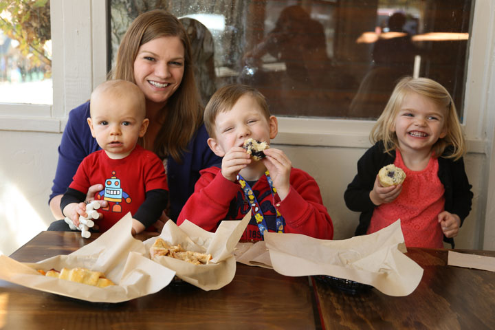 BAKE & BREW OPENS: Beth Brunett with her children, Malcolm, Jackson and Avery, enjoying their baked goods at the Grand Opening of Idyllwild Bake Shop & Brew Saturday morning, Nov. 8.            Photo by Cheryl Bayse