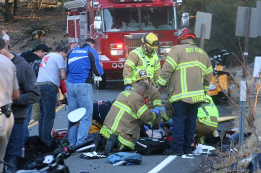 Paramedics work unsuccessfully on saving a Canadian motorcycle rider's life Monday afternoon following a collision at 3:25 p.m. with a GMC pickup driven by a Palm Desert man, according to California Highway Patrol Officer Fernandez. The rider succumbed to his injuries at the scene. The crash is still under investigation and names were not released. The crash occurred on Highway 74, east of Highway 243. Photo by Jack Clark