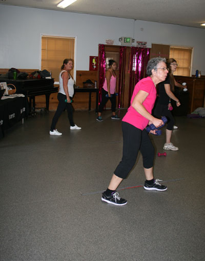 JAZZIN' AGAINST CANCER: Laurette Placencia, 63, has been fighting breast cancer for more than a year and is currently in remission. She credits Jazzercise with helping her stay healthy and is grateful for the support of her Jazzercise friends during her battle. The class honored Laurette last Thursday with a gift and inspirational notes. October was Breast Cancer Awareness month. Photo by Jay Pentrack