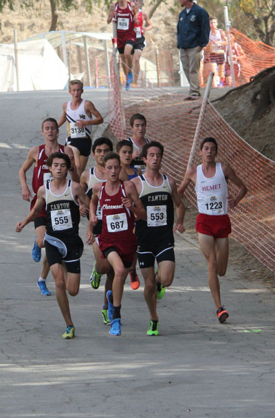EMERSON COMES IN THIRD: As the runners near the finish line, Jayden Emerson (1223) of Idyllwild, was third of 116 runners in his heat. His time of 15:23 set the Hemet High School record at this course and was 15 seconds faster than his time for the 2013 CIF-SS prelims. This weekend, Jayden will run in the Southern Section Championship, also at Mt. San Antonio College.       Photo by Jessica Priefer