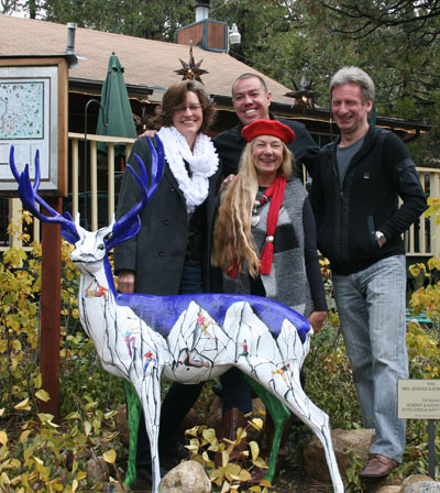 LOOK! Rocky II (to replace the stolen deer) was unveiled at its new home in front of La Casita Restaurant on Saturday. Shown are Shanna Robb (left), project coordinator on the Art Alliance of Idyllwild's Deer Sightings Project, a public art display; Donna Elliot (center) and Neil Jenkins (right), the artists who painted Rocky II with a rock-climbing theme; and Robert Garcia (back, center), La Casita owner and an avid supporter of the arts. Not pictured are deer sponsors Robert and Kathy Styles. Photo by Jay Pentrack