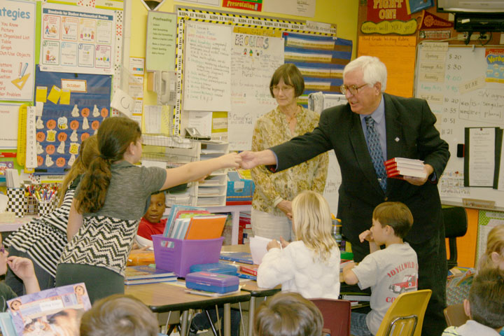 DICTIONARIES FOR ALL: Rotary members Scott Fisher (right) and John Graham handed out dictionaries to Mrs. Salter's (Jeri John is pictured) third-grade class at Idyllwild School last week as part of the national Rotary program of providing all third graders in the country with a dictionary. Both Fisher and Graham are retired teachers. The Rotary is the largest and oldest civic organization in the world. Photo by Jay Pentrack
