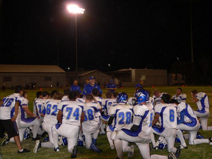 Hamilton High School football coach Keith Moorman congratulates his team on their final game, which it won 45-20 against the California Military Institute. Photo by Mike Vladika