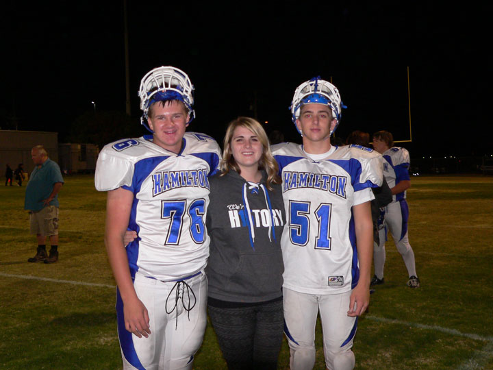 Chance Vladika (right) of Idyllwild, Brenna Campbell (center) and her brother Cole at Hamilton High School's final football game. Brenna and Cole are children of the late Jimmy Campbell, a Town Hall recreation manager.   Photo by Mike Vladika