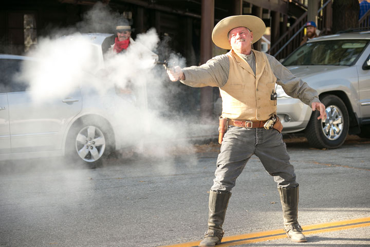 Good ol' Sheriff came to the rescue, shooting down the cowboys Saturday afternoon. The gunfighters and cowboys took over town on and near The Fort Saturday afternoon before heading to Idyology for the celebration of its grand opening Saturday night.              Photo by Jenny Kirchner