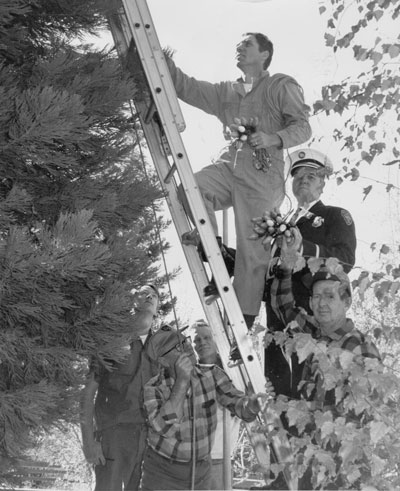 In the beginning of December 1967, Christmas started when Idyllwild firemen put up the lights in Eleanor Park (now Jo'An's). Doing the job were Bud Hunt (at top of ladder), Fire Chief George Marinak, Al Hay and, on ground at left, George Kretsinger, Bob Lane and Lee Coman. File Photo