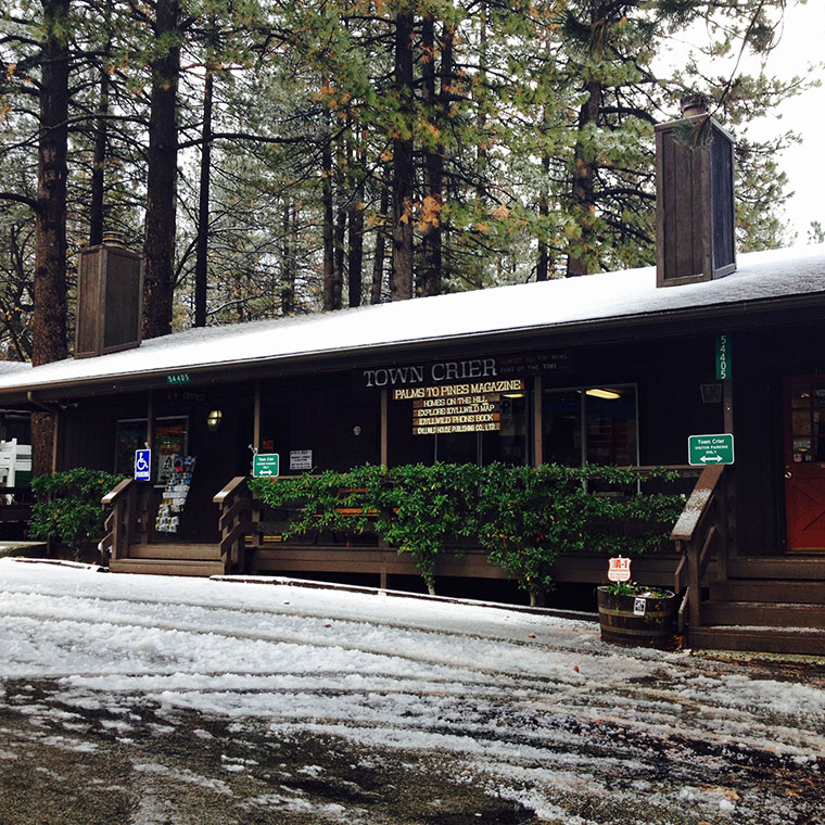 The Idyllwild Town Crier and Visitors Center on Wednesday morning after an early morning snow storm. Photo by Halie Wilson