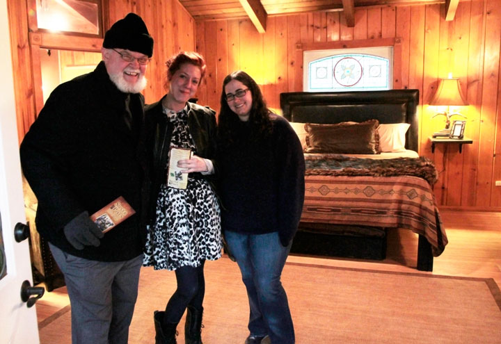 SILVER PINES VILLAGE OPENS: Doug Austin with friends Gina Rau and Shannon Levinsohn take in the cabins of the newly opened Silver Pines Village at the last week's opening. Photo by  John Drake
