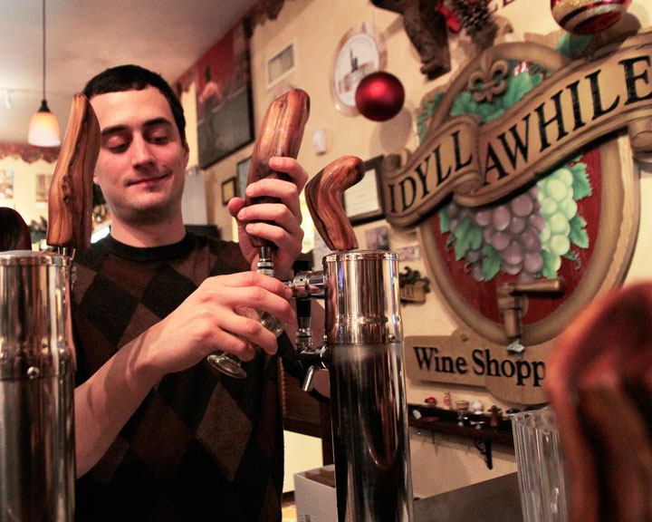 BEER TASTING: Jared Dillon, right, pulls a winter lager from tap at Idyll Awhile's Dec. 16 Christmas Beer Tasting event. Attendees enjoyed three featured beers paired with a three-course meal. Photo by John Drake.
