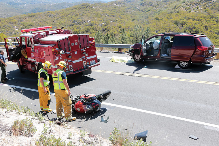 A Beaumont man riding his 2003 Honda CBR900RR motorcycle east on Highway 74 near mile marker 56.6 at about 9:45 a.m. Saturday, June 28, lost control, drifting into the westbound lane. A group leaving church camp from Idyllwild Pines was traveling westbound en route to El Cajon in a 2007 Toyota Sienna LE when the motorcyclist collided head on, pinning him under the van. First responders and witnesses used a jack to lift the van to free the motorcyclist, and CPR was administered. Later identified as Robert Knight, 34, he was pronounced deceased soon after. All seven passengers and the driver of the van were uninjured. Highway 74 was closed in both directions from Mountain Center and near Cranston Forest Service Station for about three hours while the scene was cleared.  Photo by Jenny Kirchner