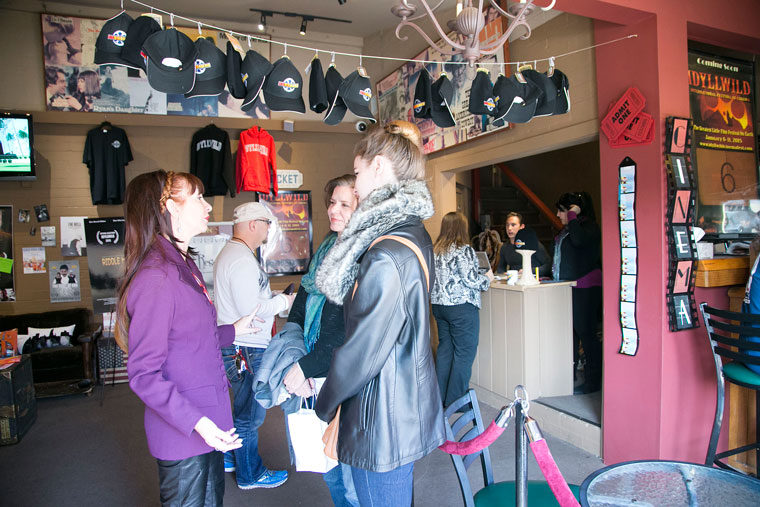 Volunteers and IIFC patrons chat in the lobby of the rustic theater Thursday afternoon. Photo by Jenny Kirchner