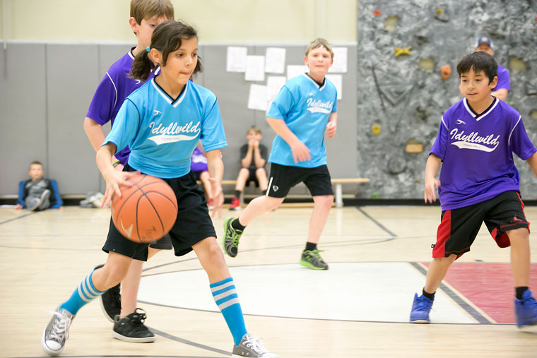 At right, Maggie McKimpson, playing for the Rustic Theatre Alpacas, heads down the court toward the hoop Monday night at Idyllwild School. Photo by Jenny Kirchner
