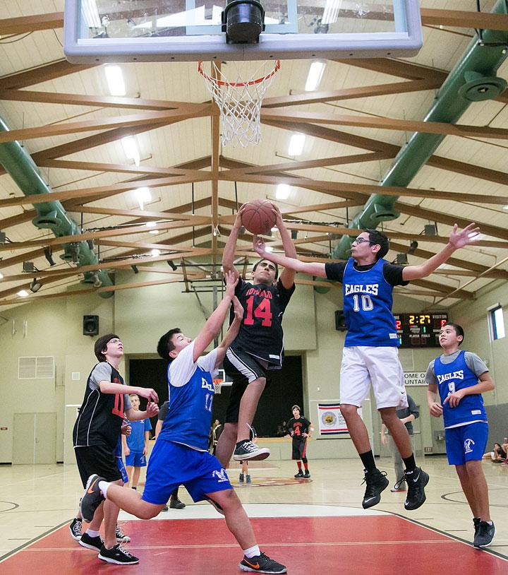 Izaiah Carman (center) shoots against Saint Hyacinth Academy Monday afternoon at Idyllwild School. Photo by Jenny Kirchner