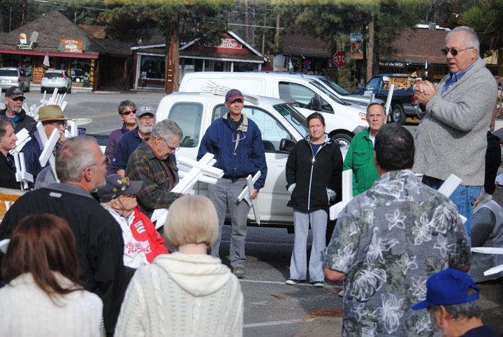 John Cook, speaks to the group in front of the town monument Wednesday, Jan. 21, before they begin their journey of planting crosses at four local churches. Photo by JP Crumrine