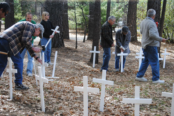 At Queen of Angels, the first of four Hill churches, 57 crosses were placed. Photo by JP Crumrine