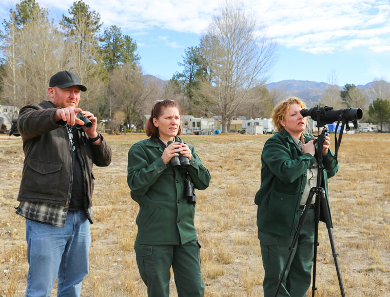 Through the help of volunteers, careful and vigilant eyes spotted two bald eagles by their nest during Saturday's U.S. Forest Service bald eagle count. Charles Reinhardt is observing the eagles along with Heidi Hoggan (center) and LaReina Van Sant of the Forest Service. Photo by Cheryl Basye