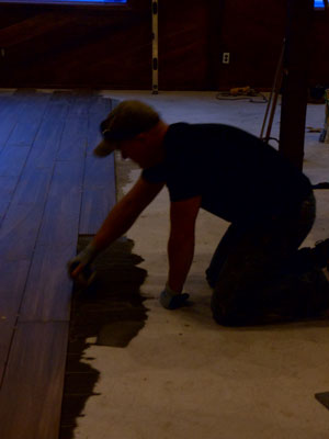 Contractor and co-owner of the Grand Idyllwild Lodge Brad Rechtfertig, lays wood-like tile in the dining area at Jo'An's Restaurant last week.       Photo by Becky Clark