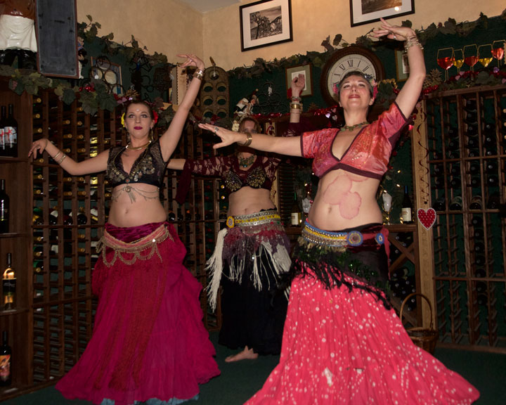 ECLECTIC ENTERTAINMENT: Jessie Estrada (left), Christina Nordella (back), and Rachel Welch (right) entertain patrons at Idyll Awhile Wine Shoppe Bistro with a night of belly dancing last Thursday. Photo by John Drake
