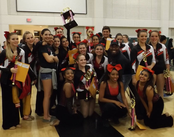 """POM CHAMPS: The Hemet High Dance Team won first placein the Pom Category at the Sharps Competition, which was hosted at Tahquitz High School Saturday, Feb. 7. The Dance Team also won """"Most Spirited."""" Breanna Lewis (second from right standing), of Idyllwild,received third place in her solo competition. Laura Tlacomulco (fourth from left), also of Idyllwild, is a member of the winning team. Photo by Kathy Lewis"""