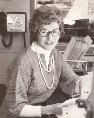 Marilyn Weare at her desk at the Town Crier in the old stone building, probably around 1973. Photo courtesy Andrea Sanborn