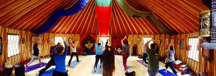 A yoga class inside the Present and Positive yurt on Double View Drive. Photo by Colin Parker