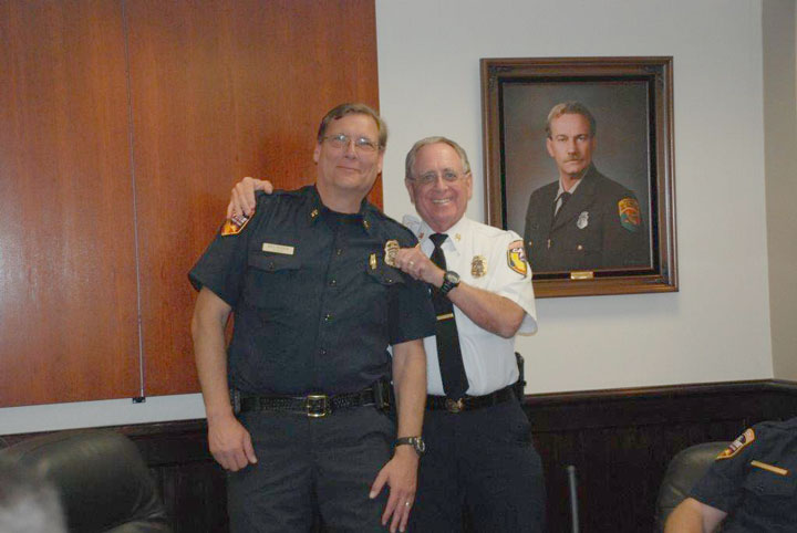 Riverside County Fire Chief John Hawkins (right) pins the promotion shield on new Bautista Division Chief Bill Weiser. Photo courtesy Jennifer Fuhrman, public safety information specialist, Riverside County Fire