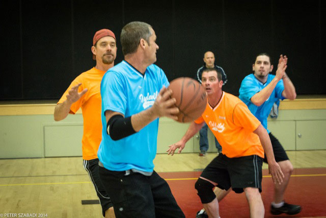 Town Hall Adult Basketball had 3-on-3 playoff action at Idyllwild School last Saturday morning. From left, Noah Whitney, Brian Kretsinger, Jessie Wilkerson and T.J. Titus with Bo Dagnall watching from the sidelines. Photo by Peter Szabadi