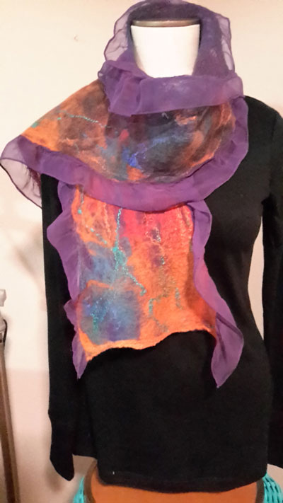 """Martha Lumia, Art Alliance of Idyllwild member, is a self-described """"fiber"""" artist, with expertise in sewing, knitting, crochet and mixed-media paper making. From 10 a.m. to 4 p.m. Saturday, Feb. 21, Lumia is presenting a workshop in """"Creating Nano Felted Silk Scarves,"""" a process employing """"hand agitating"""" wool fibers into silk. The process creates a lightweight, durable and beautiful fabric. The workshop is sponsored by AAI. Warm soapy water is applied to layers of animal hairs placed at 90-degree angles to one another. Repeated agitation and compression causes the fibers to hook together into a single piece of fabric. Lumia learned wet felting while visiting San Cristóbal de Las Casas in Chiapas, Mexico. Cost for the workshop is $75 and includes supplies and lunch. Participants are asked to bring three old bath towels and a bucket or deep container that can hold water. Of eight spaces, four are filled. Visit the AAI website for registration details at www.artinidyllwild.org. Registration deadline is Thursday, Feb. 19."""