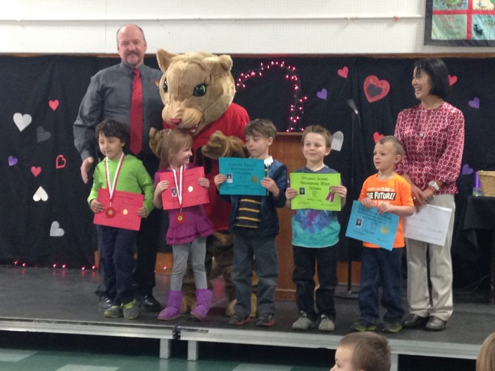 AWARDS: Students from Mrs. Draper's kindergarten class were given awards Friday by substitute Mrs. Christiansen (far right). Principal Matt Kraemer and school mascot Rocky pose with award recipients Zeyn Hagi, Kaelynn Johnston, Darius Esparza, Nathan Lady and Ryley Smith. Each elementary school grade had their own ceremony that day to receive their mid-year awards. Photo by Teresa Garcia-Lande