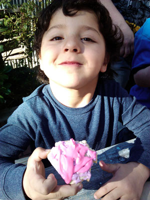 """As part ofTown Hall's """"Once Upon a Castle"""" theme, kidsdecorated their """"Royal"""" cookies at Idyllwild Bake and Brew last week. Here,Zeyn Hagi proudly shows his creation, but after he first took a big bite. Photo by Wendy Hawkins"""