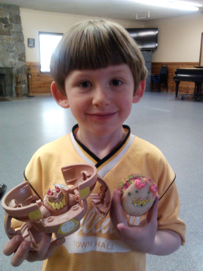 VALENTINE'S DAY CUPCAKES: Quintin Hoggan was very proud that his cupcake looked like his toy at Town Hall's St. Valentine's Day art class last Friday led by artist Mandy Johnson. Photo courtesy Wendy Watts