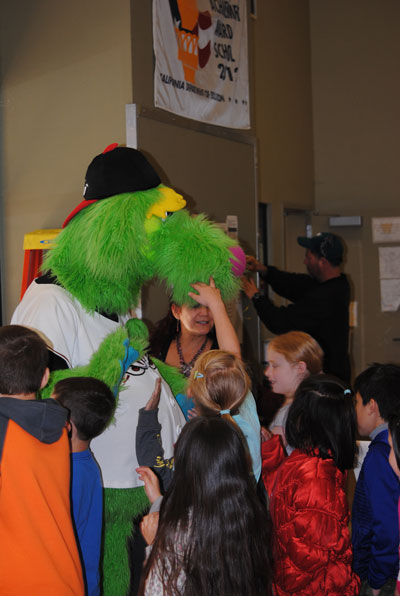 Thunder — tall, green and goofy mascot of the Lake Elsinore Storm minor league baseball team — high-five's Idyllwild School students after a presentation encouraging students to read and be healthy. Photo by Marshall Smith