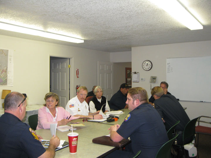 Members of Riverside County's Mountain Communities Fire Code Committee listen to San Bernardino County fire inspectors. Seated at the table (clockwise from left) are Charlie De Hart, Riverside County Fire Department; Kathleen Edwards, Pine Cove resident and formerly with Cal Fire; Idyllwild Fire Chief Patrick Reitz; Sue Nash, Idyllwild resident; Adam Gomez and Greg Torrence, San Bernardino fire inspectors; Bautista Division Chief Bill Weiser; and Joe Lewis, RCFD fire inspector. Photo by Edwina Scott