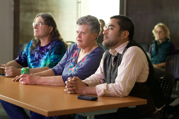 """After Idyllwild's Millionaire Acorns, the two hillbilly teams competed in Idyllwild Jeopardy at the library. Here, Team Two (from left)Richie Garcia,Kathy Gorzny andMichael Kellner, ponder the answer to """"Jiggs and Maggie escaped from their cage and ran off. What was so unusual about these two being loose in the woods?"""" Photos by Gallagher Goodland"""