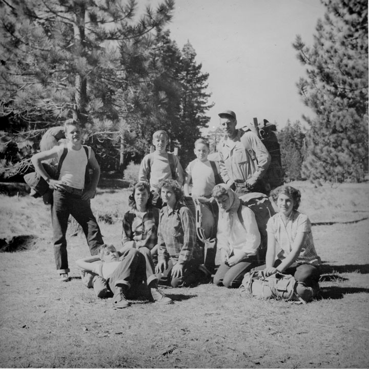 An Idyllwild youth group in Skunk Cabbage Meadow about 1955. From left, Dale Bischof and Doug Dement (lying down); seated, Pattie Davies, Gladys Turner, Carol Michelsen and Susie Shinn; standing, Pat Boss, Don Morlan and Ernest Maxwell. Photo by Ronnie Wilson