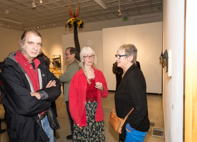 Attendees and artists visit the Sculpture Invitational Exhibit in the Parks Exhibition Center at Idyllwild Arts last Friday. From left, Dore Capitani, Trish Tuley and Michele Marsh. The exhibit runs through March 13. Photo by Peter Szabadi