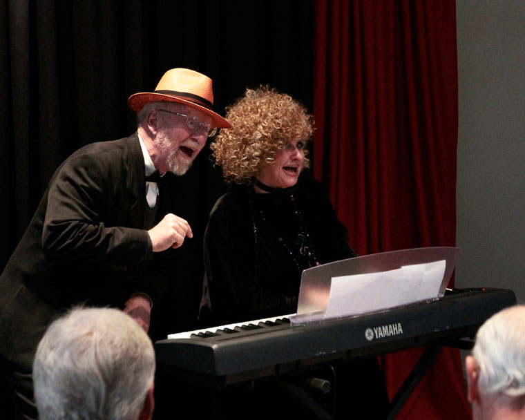 """On Sunday, Roger Bates and Barbara Rayliss perform the night's theme song """"Let Me Entertain You"""" to start off Stratford Players Black Tie Bash, which thanked supporters and patrons of the theater company at the Caine Center. Photo by John Drake"""
