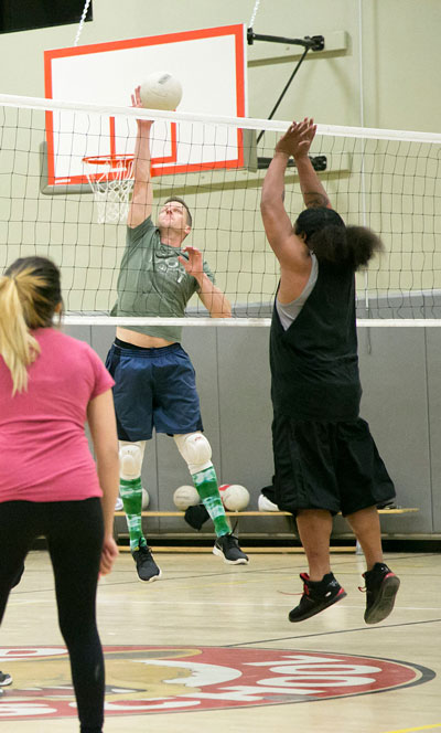 Josh White playing for Idyllwild Inn spikes the ball against the Native Islanders during Tuesday night's Town Hall Adult Volleyball game at Idyllwild School.