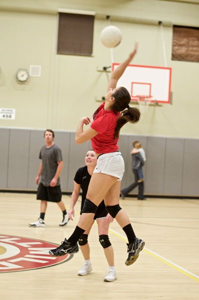 During Wednesday night's adult volleyball match, Savanah Loutzenhiser spikes the ball to help put points on the board for her team. Photo by Gallagher Goodland