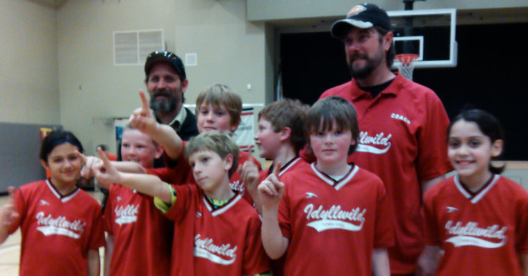 Jo'An's Heat (right) are the champs of the 9- to 11-year-old Division in Town Hall Youth Basketball. Members of the team (from left) are Hannah Lady, Ethan Teeguarden, Preston Pino, Nick Fletcher, Rene Hernandez, Cody Fogleand Ellie Reyes with coaches Chris and Lance Fogle. Not shown is Layton Teeguarden. Photos courtesy Town Hall