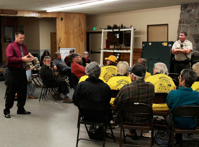 """Riverside County Sheriff's Capt. Lyndon """"Ray"""" Wood (left) and Deputy Chris Waters (right) speak to the Idyllwild community about break-ins, the Sheriff's staffing and actions to reduce the likelihood of a break-in. Photo by John Drake"""