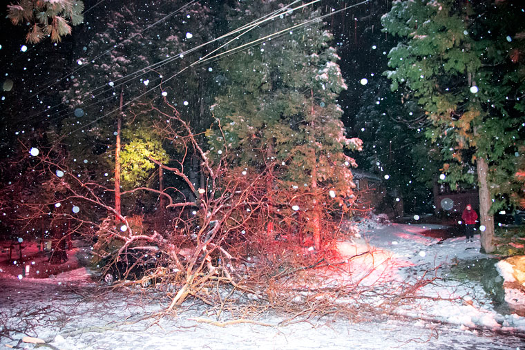A large branch fell across Hemstreet around 7:50 p.m. Sunday night. Wet, heavy snow caused the branch to snap, landing on a black sedan and arcing the power lines and causing power to go out in the area. Idyllwild Fire responded to the incident to block the road from traffic while awaiting for SCE to arrive. Photo by Jenny Kirchner