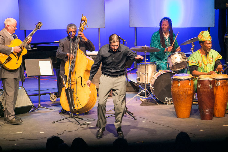 """Justin Holmes (center) adds tap dancing into the mix during the """"History of the Drum"""" event Thursday at Idyllwild Arts. Musicians providing rhythm for Holmes are (from left) Bob Boss on guitar, Marshall Hawkins on bass, Toby Williams on drums and Najite on African drums. Photo by Jenny Kirchner"""