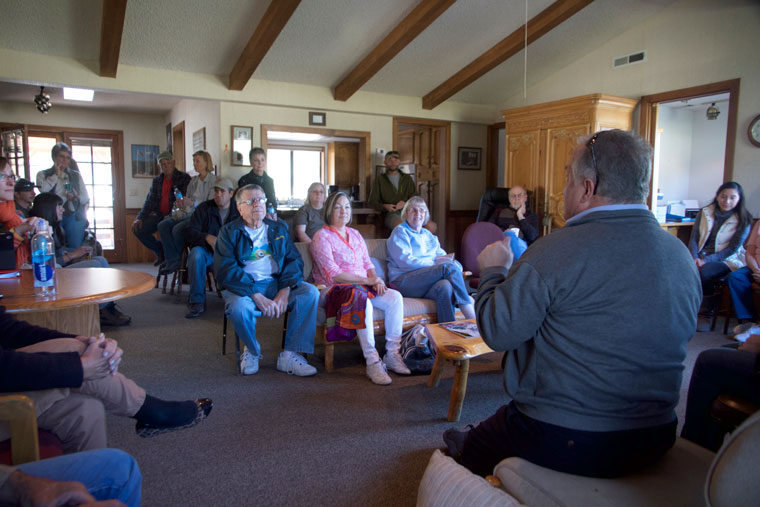 """Ed O'Rourke (back to camera), chair of the Living Free Board of Directors, addresses a gathering of volunteers, staff and residents at a """"Town Hall"""" gathering Saturday morning to discuss the new efforts to rebuild and rebrand the sanctuary. The new leadership reports that more pets were adopted out in 2014 than in the entire 30-year history of the organization. At the current rate of adoptions, this may reach 300 pets for 2015.     Photo by John Drake"""