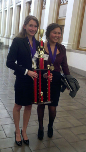 On Saturday, the Hemet High School Mock Trial team won the 32nd-annual Riverside County Mock Trial Competition. This was Hemet's first triumph. Now the team goes to the state competition. Here, Danielle Simmons (left) and Kyra Espinoza (right), both former Idyllwild School students, hold the first-place trophy. Photo by Sonia Simmons