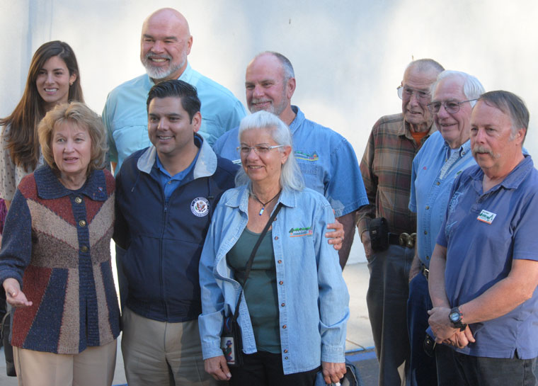 Following his tour of the Mountain Fire burned area, Congressman Dr. Raul Ruiz (front, second from left) met with the Mountain Communities Fire Safe Council. Afterward all stood for a photo. (Front, from left) Edwina Scott, MCFSC executive director, Ruiz and Doris Lombard, director. (Second row, from left) Jamie Patton, Ruiz's district director, Mike Esnard, director, Chris Kramer, MCFSC president, Larry Kueneman, second vice president, Ron Perry, director, and Norm Walker, first vice president. Photo by J.P. Crumrine