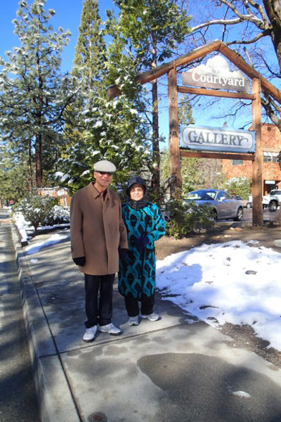Chunki, 80, and Nyunghyun, 78, Chang, who were visiting from Riverside, were out enjoying the snow on their morning walk Tuesday. Photo by Halie Wilson